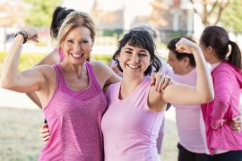 Women flexing their muscles at charity race